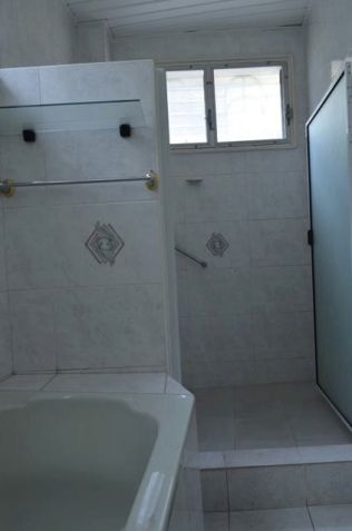 Unfurnished 4-Bedroom Home with Pool - 1
